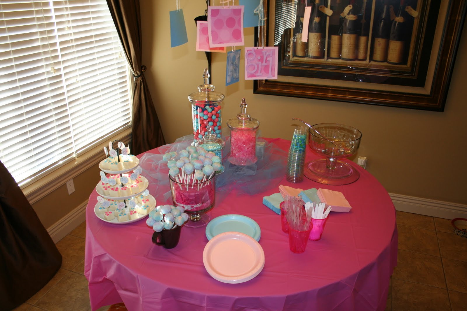 DIY baby gender reveal party pink blue tablescape
