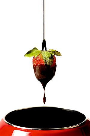 Strawberry dipped in amaretto chocolate fondue