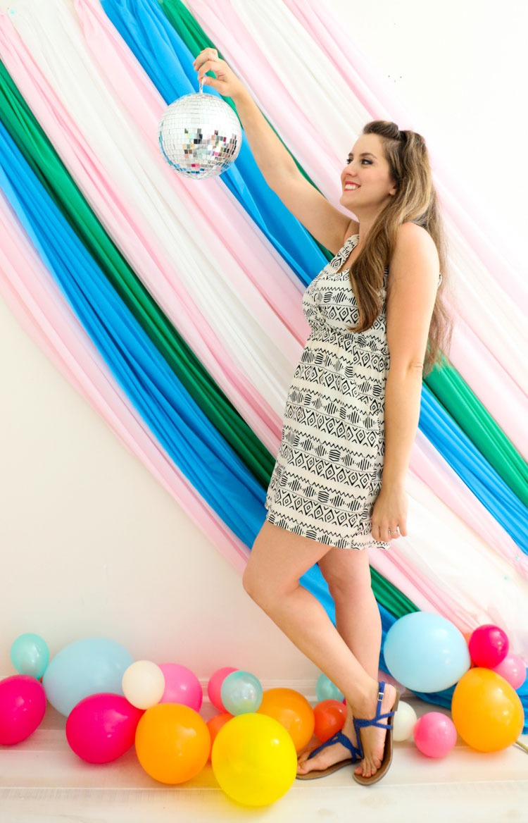 Easy sheet photo booth backdrop idea even you can make!
