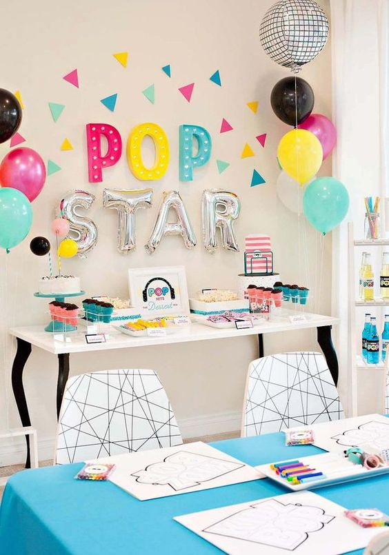 Love this rock star themed birthday party! Get party inspo here. #birthdayinspo #rockandroll #partyinspo #rockon #kidspartyideas #sendomatic #balloons #party #popstar